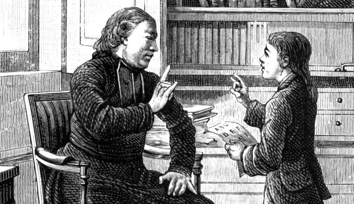 El padre Charles Michèle de lEpée enseña lenguaje de señas a un sordomudo.